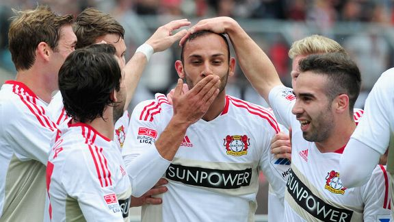 Omer Toprak celebrates with his team-mates after giving Leverkusen the lead