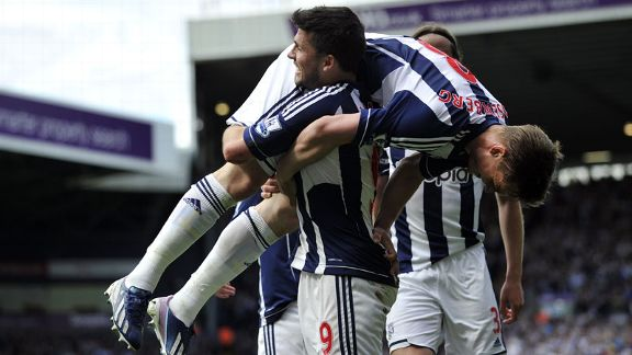 Shane Long celebrates with Marcus Rosenberg after opening the scoring against Wigan