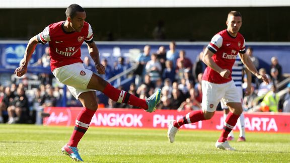 Theo Walcott gives Arsenal the early lead against QPR