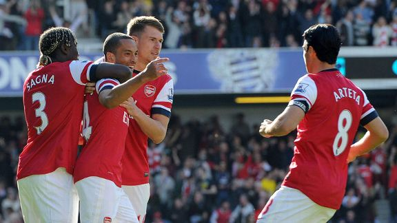 Theo Walcott celebrates after giving Arsenal the lead
