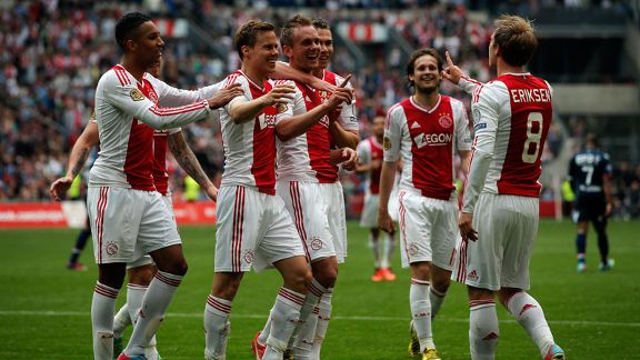 Ajax players celebrate a goal during their 5-0 win against Willem II Tilburg