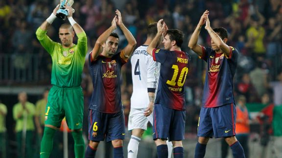 Barcelona players applaud their fans after a 2-2 draw with Real Madrid.