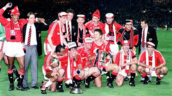 Manchester United players celebrate after winning the 1990 FA Cup, Alex Ferguson's first trophy at the club