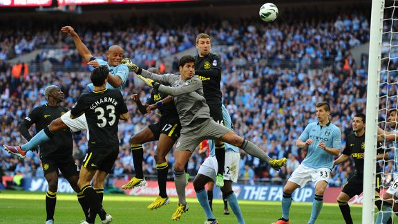 Vincent Kompany misses the target with a header early in the second half