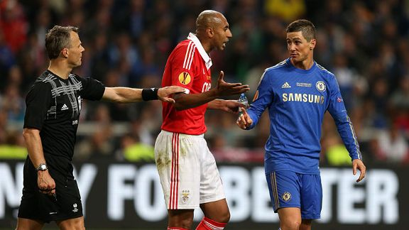 Luisao complains to Fernando Torres after the Spain striker went down in the area