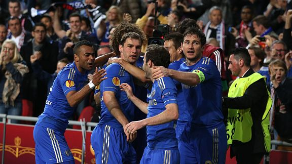 Chelsea mob Branislav Ivanovic after his late winner