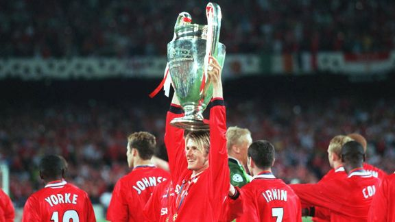 David Beckham set up both goals as Man U came from behind to beat Bayern Munich in the Champions League and complete the treble