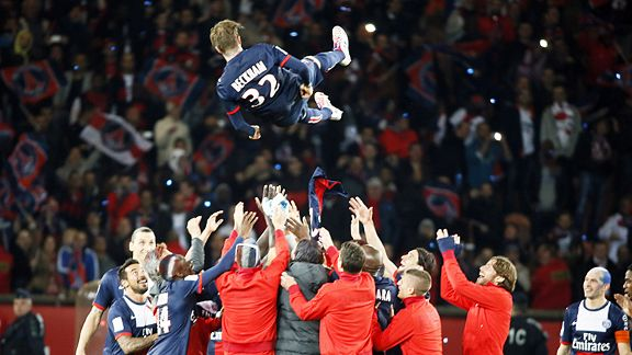 David Beckham is lofted in the air by his PSG team-mates after the game against Brest