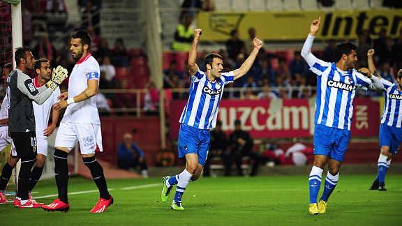 Real Sociedad celebrate after Sevilla's Ivan Rakitic put through his own net. Sociedad won 2-1.