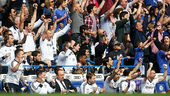 Rafa Benitez stays glued to his notes as Stamford Bridge celebrates Juan Mata's goal against Everton