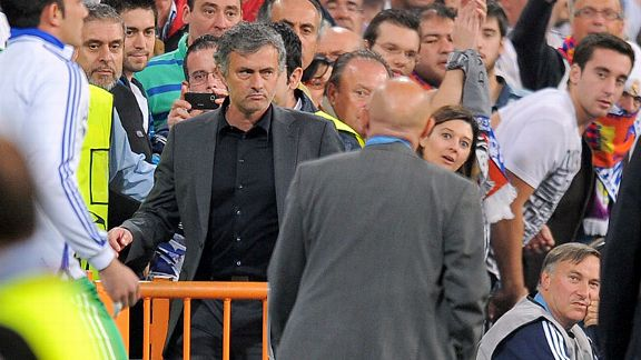 Jose Mourinho tries to squeeze into the stand after being sent off.