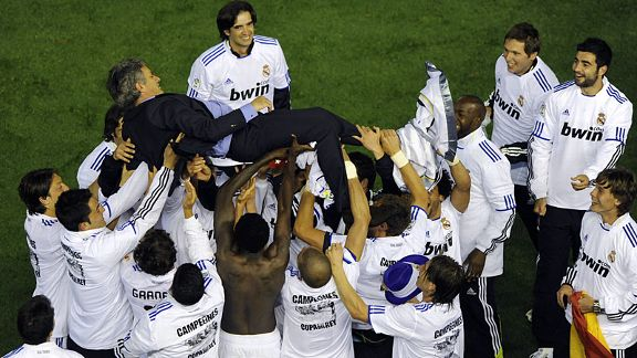 Real Madrid celebrate their cup win over rivals Barcelona with coach Jose Mourinho.