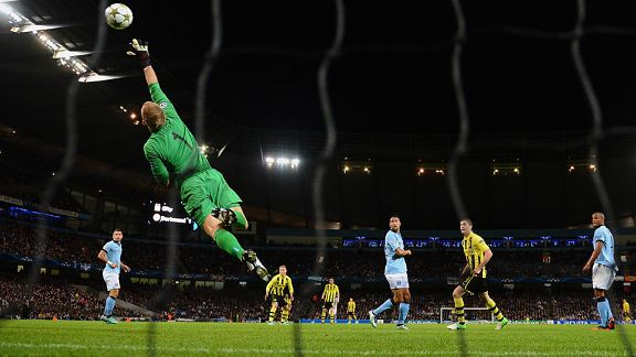 Manchester City Joe Hart makes one of many saves against Borussia Dortmund