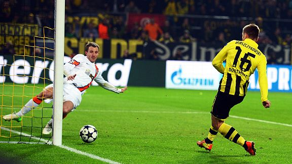 Jakub Blaszczykowski scores for Dortmund in their last-16 win over Shakhtar Donetsk