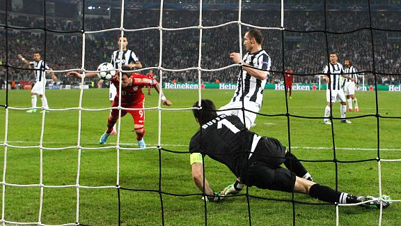 Mario Mandzukic stoops to head home in the first leg of Bayern Munich's emphatic quarter-final victory over Juventus