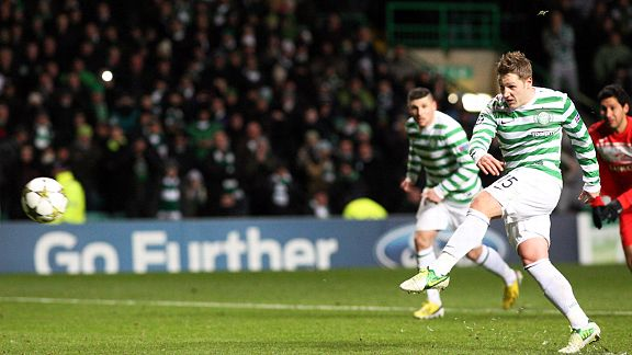 Kris Commons blasts home from the penalty spot to put Celtic into the next round of the Champions League