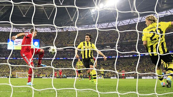 Mario Mandzukic scores from close range to give Bayern the lead against Dortmund