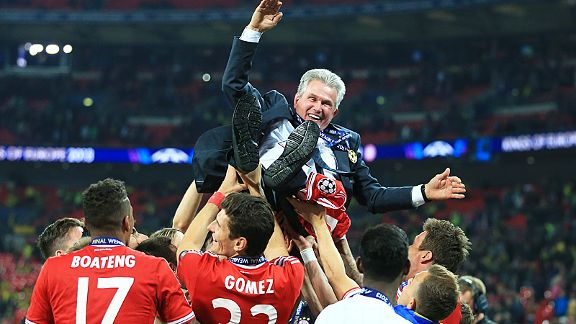 Bayern Munich coach Jupp Heynckes is raised high in the air by his players