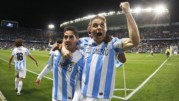Joaquin goes a little crazy as he joins the scorer of Malaga's goal, Isco.