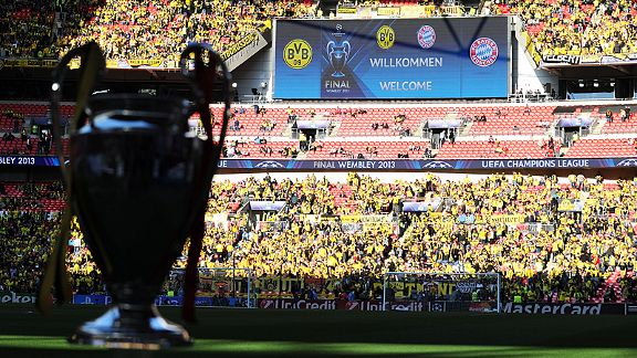 The Champions League trophy stands proud as Borussia Dortmund fans begin to fill Wembley early