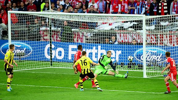 Manuel Neuer makes a fine save with his foot to deny Dortmund skipper Jakub Blaszczykowski