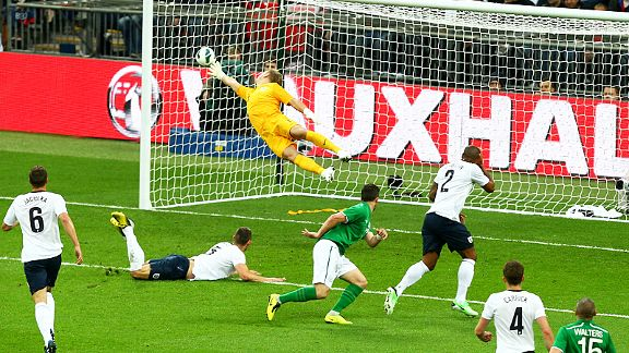 Joe Hart is powerless as Shane Long watches his fine header find the back of the England net