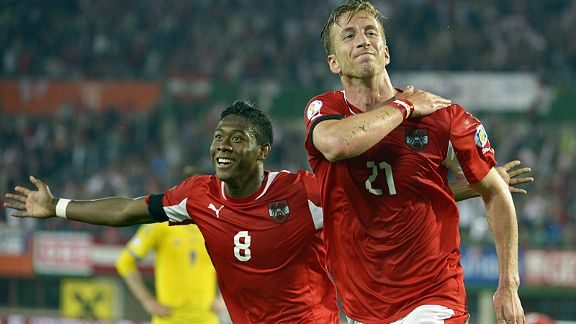 David Alaba, scorer of Austria's first goal, celebrates with Marc Janko after he grabbed the second in a huge 2-1 win over Sweden