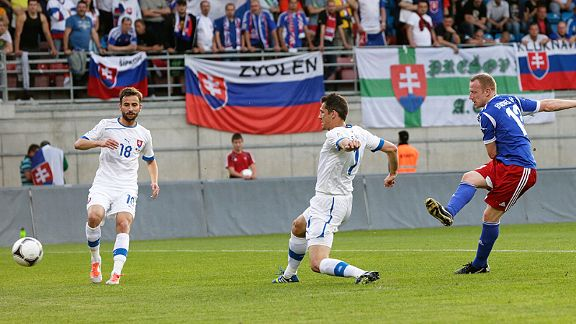 Martin Buchel fires home in the 13th minute for Liechtenstein against Slovakia. It was Liechtenstein second point of qualifying and left Slovakian hopes in tatters