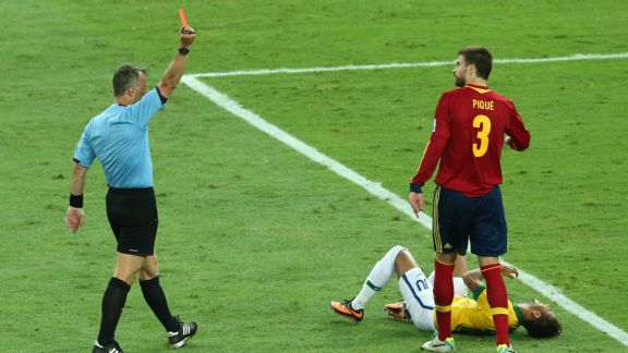Spanish defender Gerard Pique is shown a straight red for his lunge on Neymar.