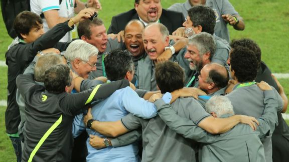 Luiz Felipe Scolari celebrates with his staff after Brazil claimed the Confederations Cup.
