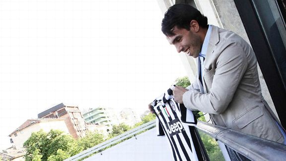 Carlos Tevez signed a three-year contract with Juventus