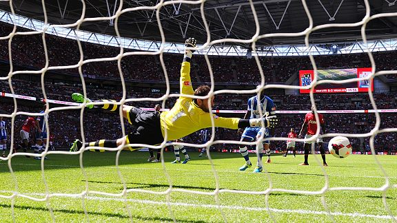 Scott Carson dives in vain to try and keep out Robin van Persie's header