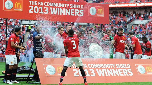 Patrice Evra showers his team-mates with Champagne after the Community Shield victory over Wigan