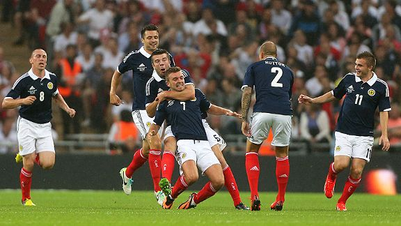 Scotland celebrate their 11th-minute goal against England at Wembley.