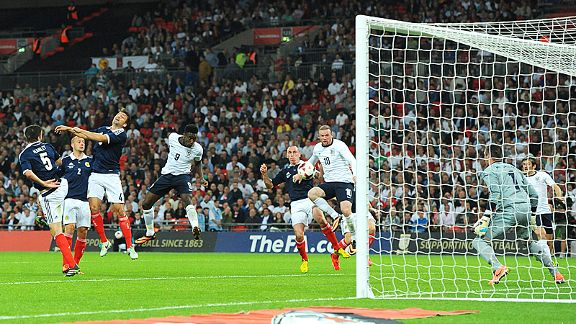 Danny Welbeck heads home England's second equaliser against Scotland.