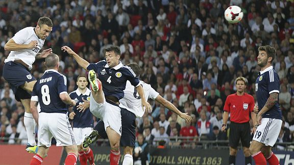 Rickie Lambert heads home England's winner against Scotland