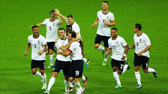 A delighted England team celebrate after Rickie Lambert's bullet header