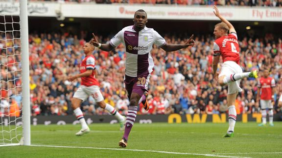 Christian Benteke wheels away after his goal for Aston Villa at Arsenal.