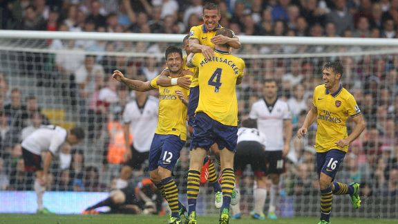 Arsenal celebrate taking a 2-0 lead through Lukas Podolski.