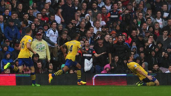 Olivier Giroud celebrates after giving Arsenal the early lead.
