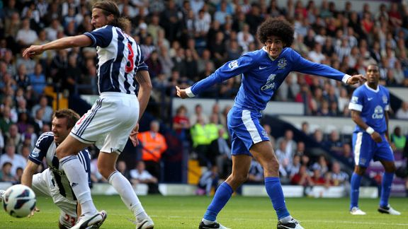 Gareth McAuley and Jonas Olssen and Marouane Fellaini battle Everton v West Brom