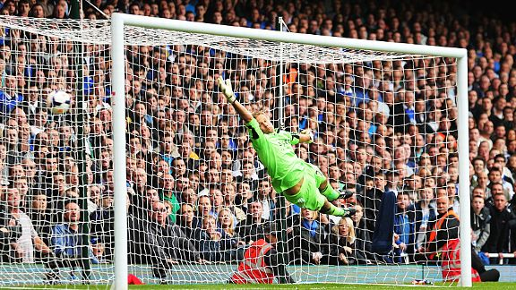 Jussi Jaaskelainen is powerless to keep out Leighton Baines' first free-kick.