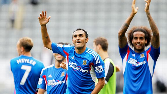 Ahmed Elmohamady, scorer of Hull's second goal, leads the full-time celebrations at Newcastle.