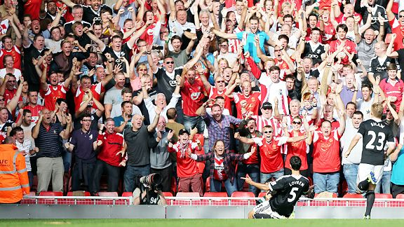 Dejan Lovren celebrates with the Southampton fans after scoring his winner at Livepool.