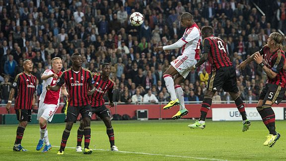 Stefano Denswil heads Ajax in front against AC Milan in the 90th minute.