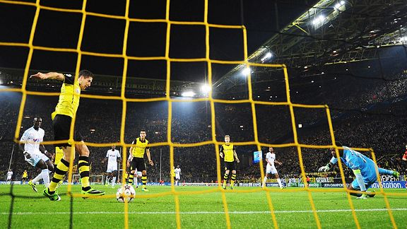 Robert Lewandowski makes no mistake from close range to give Dortmund the lead against Marseille.