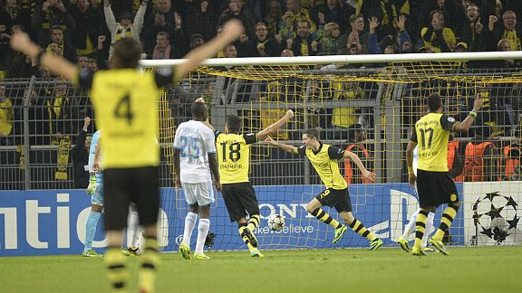 Borussia Dortmund celebrate after Robert Lewandowski scored against Marseille.