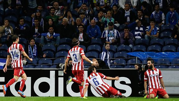 Atletico Madrid celebrate after Arda Turan (r) scored a dramatic late winner at Porto.