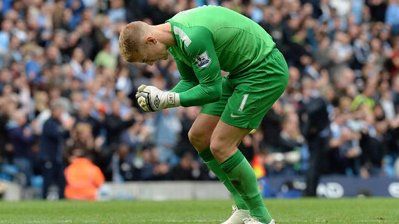 Joe Hart celebrates Man City's third goal against Everton.