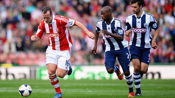 Youssuf Mulumbu keeps tabs on Charlie Adam